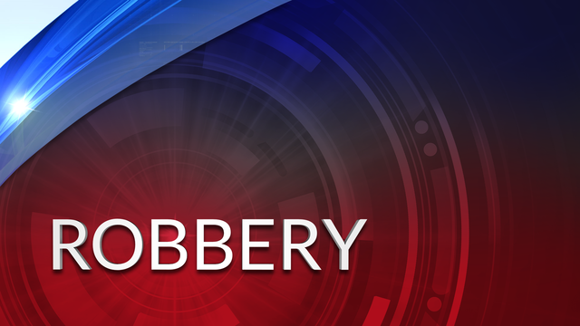Police Investigating Armed Robbery at a Residence
